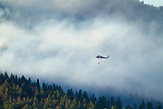 Helicopter fighting forest fire, Montana.