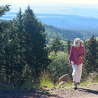 Joan Boyden, of Grants, is seen hiking on Mount Taylor Monday afternoon.