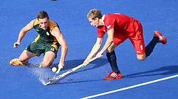 Lloyd Madsen of South Africa tackles Harry Martin of Great Britain during the men's hockey match between South Africa and Great Britain held at the Riverbank Arena at Olympic Park in London as part of the London 2012 Olympics on the 1st August 2012..Photo by Ron Gaunt/SPORTZPICS
