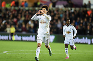 Ki Sung-Yueng of Swansea city © celebrates after he scores his teams 1st goal. Barclays Premier league match, Swansea city v Queens Park Rangers at the Liberty stadium in Swansea, South Wales on Tuesday 2nd December 2014<br /> pic by Andrew Orchard, Andrew Orchard sports photography.