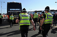 Police escort the Wales team bus outside the stadium before k/o. . Euro 2016 qualifying match, Wales v Israel at the Cardiff city stadium in Cardiff, South Wales on Sunday 6th Sept 2015.  pic by Andrew Orchard, Andrew Orchard sports photography.