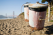 Garbage cans on Baker Beach near the Golden Gate Bridge in San Francisco, California.