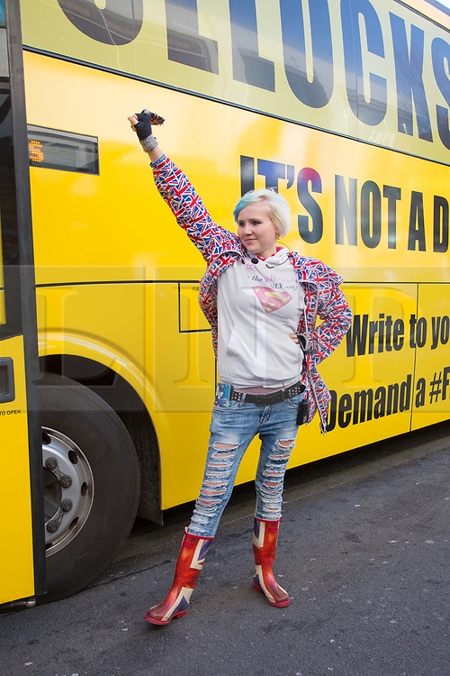 """@Licensed to London News Pictures 12/12/2018. Maidstone, Kent.  Campaigner, Madaleina Kay poses outside the yellow anti-Brexit bus today in Maidstone. The official anti-Brexit tour bus branded with the words """"Bollocks To Brexit"""" arrives outside Jubilee Square in Maidstone today. Campaigners for the 2nd referendum are on a nationwide tour across the UK, Belgium and Ireland promoting public debate the benefits of remaining in the EU.Photo credit: Manu Palomeque/LNP"""