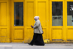 © Licensed to London News Pictures. 20/05/2021. London, UK. A woman wearing a face mask walks along Hounslow High Street, West London. Hounslow is the first London borough to actively test for the Indian Covid variant B.1.617.2. Photo credit: Ray Tang/LNP