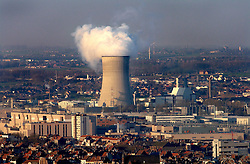 BRUSSELS, BELGIUM - APRIL-04-2007 - Brussels city scape showing trash burning power plant with smoke rising from the cooling tower. (Photo © Jock Fistick)