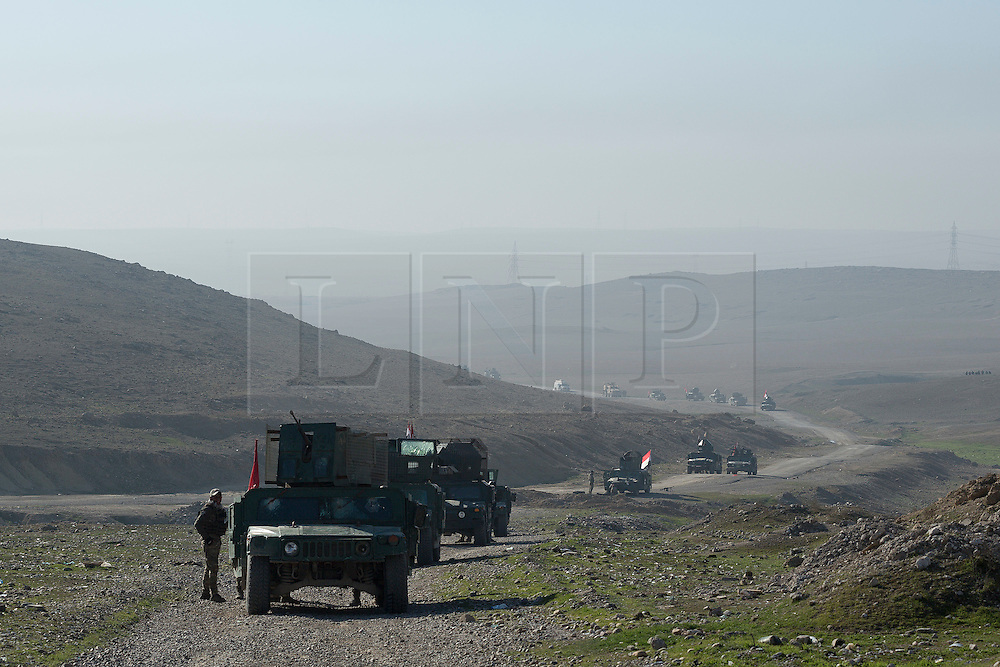 Licensed to London News Pictures. 20/02/2017. Albu Saif, Iraq. A convoy of Iraqi Federal Police and Emergency Response Division soldiers advance towards Albu Saif as they take part in the offensive to retake western Mosul from the Islamic State.<br /> <br /> The settlement of Albu Saif is located on high ground overlooking Mosul Airport and as such is a strategic point that needs to be taken as part of the operation to retake the western side of Mosul. Photo credit: Matt Cetti-Roberts/LNP