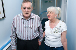 Woman who is visiting her husband with Alzheimer's Disease walking down the Nursing Home corridor,