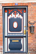 Painted ornate door in medieval Ribe centre, South Jutland, Denmark