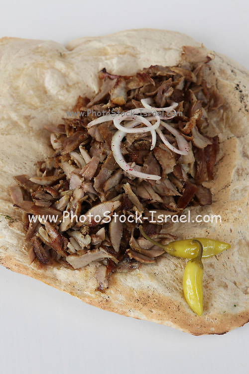 Shawarma shavings in a Lafa -  flat Iraqi pita with pickles. A popular fast food in Israel and the Middle East