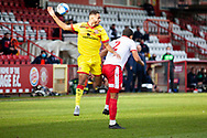 James Clarke of Walsall and Luther Wildin of Stevenage as they both mis a header during the EFL Sky Bet League 2 match between Stevenage and Walsall at the Lamex Stadium, Stevenage, England on 20 February 2021.