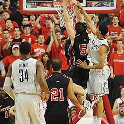 Connecticut Huskies guard/forward Jeremy Lamb (3) fouls Rutgers Scarlet Knights forward Gilvydas Biruta (55) on a slam dunk attempt during Rutgers' 67-60 upset victory over #8 UConn in NCAA Big East Basketball action at the Louis Brown Athletic Center in Piscataway, N.J. on Jan 7, 2012.
