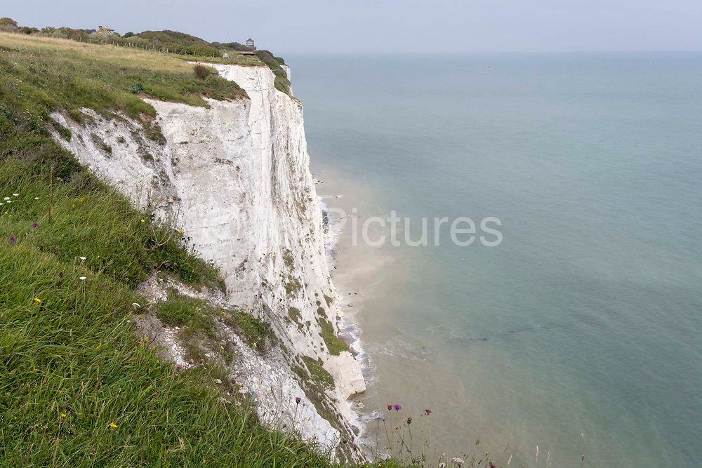 A hilltop landscape of Englands iconic White Cliffs, under threat from chalk and soil erosion, on 27th July, in St Margarets at Cliffe, in Kent, England.