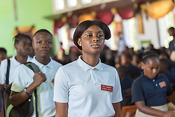 4 November 2019, Vriginia, Liberia: Students exit the main hall after morning devotion at Ricks Institute. The Liberia Baptist Convention runs Ricks Institute, a day and boarding school for currently 496 students from kindergarten up through 12th grade.