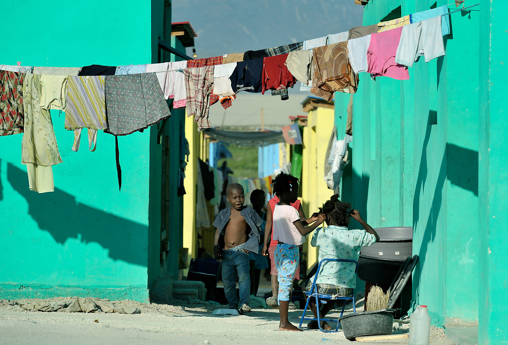New housing for some families has been built by a Catholic group in Cite Soleil, a neighborhood of Port-au-Prince, Haiti, one year after a devastating earthquake leveled the country's capital.