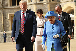 Queen Elizabeth II, US President Donald Trump, first lady Melania Trump and Lieutenant Colonel Sir Andrew Ford walk in the Quadrangle during a ceremonial welcome at Windsor Castle, Windsor.
