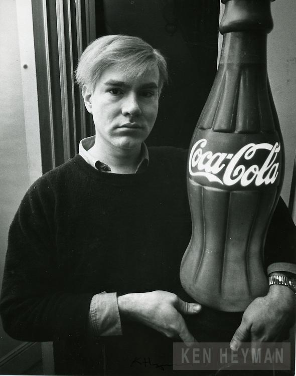 Warhol with a coca cola prop.