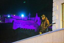 Armed Police on a shop roof on Princes Street. Edinburgh's Hogmanay 2019