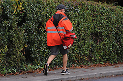 © Licensed to London News Pictures. 15/10/2013<br /> A postman in Hildenborough,Kent 14/10/2013.<br /> Royal Mail share price rise.<br /> Royal Mail shares soar to £4.50: Price is now 50% higher than at sell-off renewing claims it was undervalued.<br /> Photo credit :Grant Falvey/LNP