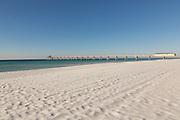Okaloosa Island Pier along an empty beach in Fort Walton Beach, Florida.