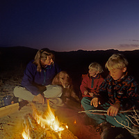 A family sits around a campfire in Eureka Valley, before it became part of Death Valley National Park.