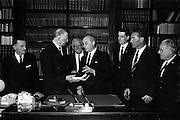 "05/04/1965<br /> 04/05/1965<br /> 05 April 1965<br /> Presentation of books to President Eamon de Valera. Two complete volumes of the ""History of Motion Pictures"" by Terry Ramsey and Mark Quigley (Jr.), were presented to President de Valera as patron of the Society by the Theatre and Cinema Benevolent Society of Ireland at Aras an Uachtarain. Picture shows the President receiving the volumes from Mr Louis Elliman (right), Chairman of the Society. Also in the picture is Mr Frank Robbins, (centre) Vice-chairman of the Society."