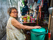 13 AUGUST 2016 - BANGKOK, THAILAND: A woman who lives in the Pom Mahakan slum sells snacks and household supplies from her home in the slum. Residents of the slum have been told they must leave the fort and that their community will be torn down. The community is known for fireworks, fighting cocks and bird cages. Mahakan Fort was built in 1783 during the reign of Siamese King Rama I. It was one of 14 fortresses designed to protect Bangkok from foreign invaders. Only of two are remaining, the others have been torn down. A community developed in the fort when people started building houses and moving into it during the reign of King Rama V (1868-1910). The land was expropriated by Bangkok city government in 1992, but the people living in the fort refused to move. In 2004 courts ruled against the residents and said the city could take the land. Eviction notices have been posted in the community but most residents have refused to move. Residents think Bangkok city officials will start evictions around August 15, but there has not been any official word from the city.      PHOTO BY JACK KURTZ