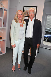 PRINCE NICHOLAS VON PREUSSEN and SARAH MACMILLAN at a party to celebrate the launch of Bentley's The Collection held at 6 Square Rigger Row, Plantation Wharf, York Road, London SW11 on 25th June 2012.