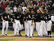 CHICAGO - APRIL 24:  The White Sox gather at home plate to greet Alex Rios #51 of the Chicago White Sox after Rios hit a walk-off, two-run home run against David Aardsma #53 of the Seattle Mariners on April 24, 2010 at U.S. Cellular Field in Chicago, Illinois.  The White Sox defeated the Mariners 5-4.  (Photo by Ron Vesely)