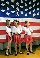 """wait to perform in """"Music America"""" at Wilbur Ave. Elementary Thursday morning. Fortyfour kids  from 2nd through 5th grade participated in the show celebrating American music, songs and dance by the decade."""