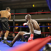 Mike Bolagun of Upper Marlboro, Maryland (L) knocks down Terrance Marbar of St. Pete, Florida during a heavyweight clash during a Nelsons Promotions boxing match at the Boca Raton Resort  and Club on Friday, May 26, 2017 in Boca Raton, Florida.  (Alex Menendez via AP)