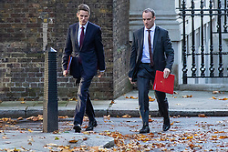 © Licensed to London News Pictures. 13/11/2018. London, UK. Defence Secretary Gavin Williamson (L) and Secretary of State for Exiting the European Union Dominic Raab (R) arrive on Downing Street for the Cabinet meeting. Photo credit: Rob Pinney/LNP