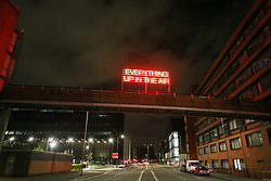 © Licensed to London News Pictures. 21/10/2021. Manchester, UK.  A new work by British artist Tim Etchells is displayed on the bridge over Booth Street East on the opening night of the 'Corridor of Light' festival in Manchester city centre. The new arts festival is designed as a celebration of the Oxford Road Corridor innovation district, an economically important area stretching south from St. Peter's Square which includes The University of Manchester, Manchester Metropolitan University, the Royal Northern College of Music and Manchester Science Park. Photo credit: Adam Vaughan/LNP