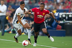 July 15, 2017 - Carson, California, U.S - Manchester United D Antonio Valencia (25) and Los Angeles Galaxy F Ariel Lassiter (15) in action during the summer friendly between Manchester United and the Los Angeles Galaxy at the StubHub Center. (Credit Image: © Brandon Parry via ZUMA Wire)