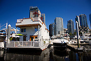 Houseboat, downtown Vancouver from Coal Harbour, British Columbia, Canada.