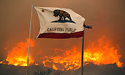 June 20, 2016 - Duarte, California, U.S. - The California state flag flies next to a home on Highway 94 south Potrero on Monday as huge flames roar behind it.<br /> ©Exclusivepix Media