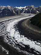Aerial view of curving Ruth Glacier with Mount Church, The Mooses Tooth and Glacier Point beyond, Alaska Range, Denali National Park, Alaska.