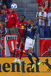 July 21, 2018 - Harrison, NJ, U.S. - HARRISON, NJ - JULY 21:  New York Red Bulls defender Kemar Lawrence (92) goes up for a head ball against New England Revolution forward Teal Bunbury (10) during the first half of the Major League Soccer game between the New York Red Bulls and the New England Revolution on July 21, 2018, at Red Bull  Arena in Harrison, NJ.(Photo by Rich Graessle/Icon Sportswire) (Credit Image: © Rich Graessle/Icon SMI via ZUMA Press)