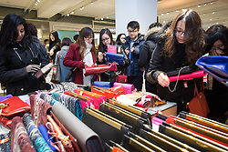 © Licensed to London News Pictures . 26/12/2013 . Manchester , UK . Shoppers in Selfridges crowd around reduced handbags . Queues for Selfridges in Manchester , ahead of an 8am opening . Thousands of shoppers queue for hours in freezing temperatures in Manchester this Boxing Day morning (26th December 2013) in order to be amongst the first to purchase reduced price products in shops' sales . Photo credit : Joel Goodman/LNP