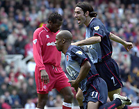 Photo: Greig Cowie<br />Middlesbrough v Arsenal. Barclaycard Premiership 19/04/2003<br />Robert Pires celebrates Sylvain WIltords goal as Ugo Ehiogu hangs his head