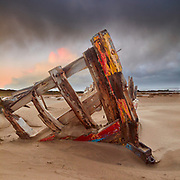 """Skeleton of the wrecked barge """"Sea Mac"""" buried in the sand at Crow Point Braunton Devon"""