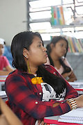 At school: Indigenous teachers run a comprehensive course in environmental education, using diagrams and charts made from the Surui territory<br /><br />An Amazonian tribal chief Almir Narayamogo, leader of 1350 Surui Indians in Rondônia, near Cacaol, Brazil, with a $100,000 bounty on his head, is fighting for the survival of his people and their forest, and using the world's modern hi-tech tools; computers, smartphones, Google Earth and digital forestry surveillance. So far their fight has been very effective, leading to a most promising and novel result. In 2013, Almir Narayamogo, led his people to be the first and unique indigenous tribe in the world to manage their own REDD+ carbon project and sell carbon credits to the industrial world. By marketing the CO2 capacity of 250 000 hectares of their virgin forest, the forty year old Surui, has ensured the preservation, as well as a future of his community. <br /><br />In 2009, the four clans and 25 Surui villages voted in favour of a total moratorium on logging and the carbon credits project. <br /><br />They still face deforestation problems, such as illegal logging, and gold mining which causes pollution of their river systems
