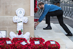 London, UK. 10 November, 2019. Ben Griffin lays a white poppy wreath at the Cenotaph in front of fellow ex-services personnel from Veterans For Peace UK (VFP UK) taking part in the Remembrance Sunday ceremony in Whitehall. VFP UK was founded in 2011 and works to influence the foreign and defence policy of the UK for the larger purpose of world peace.