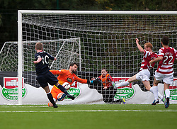 Hamilton's Kevin Cuthbert saves from Falkirk's Craig Sibbald.<br /> Half time : Hamilton 1 v 0 Falkirk, Scottish Championship played today at New Douglas Park.<br /> ©Michael Schofield.