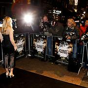 NLD/Amsterdam/20100308 - Premiere film Zwart Water, Hadewych Minis poseert voor de anwezige fotografen