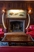 The fireplace in the members' lounge of The Explorers Club is  flanked by two elephant tusks.