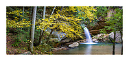 A waterfall in autumn at Old Man's Cave in the Hocking Hills Region of central Ohio, USA