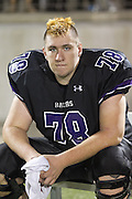 Senior lineman, Matthew Cooper, rests on the bench during the Bowie game at Kelly Reeves Athletic Complex.  (LOURDES M SHOAF for Round Rock Leader)