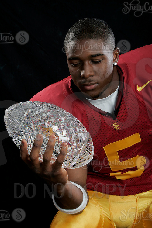 7 April 2005:NCAA Pac-10 USC Trojan Reggie Bush with the National Championship Crystal Football Trophy  For Editorial Use ONLY Credit must be given -  Photo by:  Shelly Castellano.com