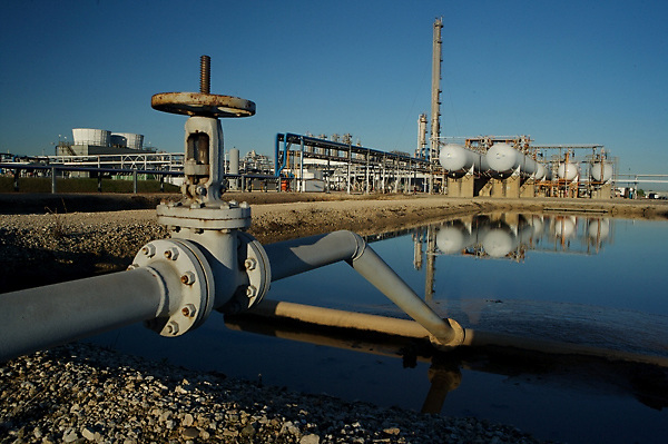 Stock photo of pipes and storage tanks at a chemical plant