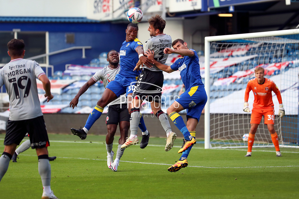 AFC Wimbledon defender Paul Kalambayi (30) and AFC Wimbledon attacker Adam Roscrow (10) battles for possession with Charlton Athletic defender Ben Purrington (3) during the EFL Trophy Group O match between AFC Wimbledon and Charlton Athletic at the Kiyan Prince Foundation Stadium, London, England on 1 September 2020.